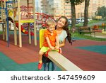 active little boy on playground.... | Shutterstock . vector #547459609