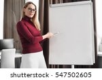 young businesswoman writing on... | Shutterstock . vector #547502605