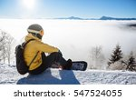 snowboarder sitting and looking ... | Shutterstock . vector #547524055