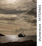 A Fishing Boat Entering Harbou...