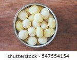 Raw Peeled Potatoes In A Round...