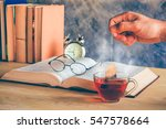 hand of man dripping tea bag in ...   Shutterstock . vector #547578664