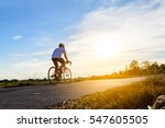 man ride a bicycle at sun set ... | Shutterstock . vector #547605505