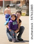 Small photo of RENACA, CHILE - NOV 6, 2014: Unidentified Chilean woman and her little girl. Chilean people are of mixed Spanish and Amerindian descent