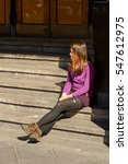 Small photo of VALPARAISO, CHILE - NOV 9, 2014: Unidentified Chilean girl on the stairs in Valparaiso. Chilean people are of mixed Spanish and Amerindian descent