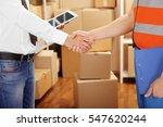two businessmen shaking hands...   Shutterstock . vector #547620244