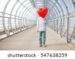 boy hid his face behind a red...   Shutterstock . vector #547638259