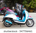 Several Colorful  Generic Moped ...
