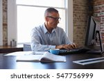 mature businessman working on... | Shutterstock . vector #547756999