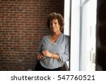 mature businesswoman standing... | Shutterstock . vector #547760521