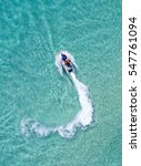 people are playing a jet ski in ... | Shutterstock . vector #547761094