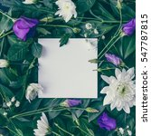 Stock photo creative layout made of flowers and leaves with paper card note flat lay nature concept 547787815