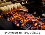 a chimney cake is baked over an ... | Shutterstock . vector #547798111
