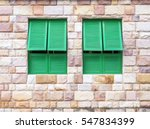 Green Window On A Brick Wall