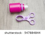 toy scissors and bottle | Shutterstock . vector #547884844