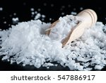 salt flakes and wooden scoop on ... | Shutterstock . vector #547886917