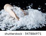 salt flakes and wooden scoop on ... | Shutterstock . vector #547886971