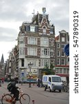 Small photo of 14 july 2012. A typical Amsterdam street with cyclist and cafe. Netherlands.