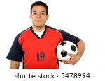 male footballer holding a ball over a white background - stock photo