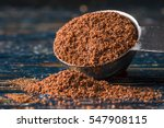 ground cloves spilling from a...   Shutterstock . vector #547908115