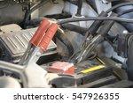 car with open hood in a repair...   Shutterstock . vector #547926355
