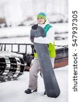 young man standng on the snow... | Shutterstock . vector #547937305