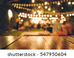 image of wooden table in front... | Shutterstock . vector #547950604