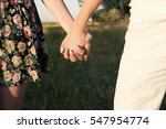a young couple is jolding each... | Shutterstock . vector #547954774