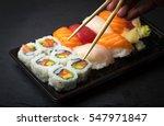 hand using chopsticks pick... | Shutterstock . vector #547971847