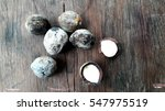 Small photo of candlenuts, also known as aleurites moluccanus on a wooden table