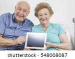 senior citizen working and... | Shutterstock . vector #548008087