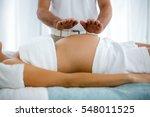 pregnant woman receiving a... | Shutterstock . vector #548011525