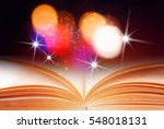 abstract magic book on wooden... | Shutterstock . vector #548018131