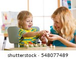 mother and child learn color ... | Shutterstock . vector #548077489
