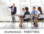 positive senior leader drawing... | Shutterstock . vector #548077801