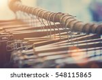 many wooden hangers on a stick. ... | Shutterstock . vector #548115865