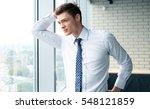 handsome businessman looking... | Shutterstock . vector #548121859