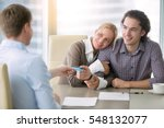 Small photo of Young happy couple getting a loan concept, first time home buyers, tenancy agreement, agency as a broker between the landlord and tenant, signed all paper and paying with credit card