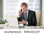 young handsome businessman... | Shutterstock . vector #548132119