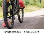 woman riding a mountain bicycle ...   Shutterstock . vector #548180275