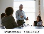 Group Of Businesspeople Meetin...
