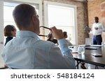 group of businesspeople meeting ... | Shutterstock . vector #548184124