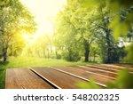 wooden table in garden of... | Shutterstock . vector #548202325