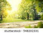 wooden table in garden of... | Shutterstock . vector #548202331