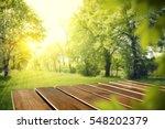 wooden table in garden of... | Shutterstock . vector #548202379