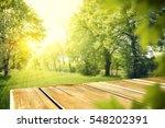wooden table in garden of... | Shutterstock . vector #548202391