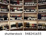 wine bottles on wooden shelves... | Shutterstock . vector #548241655