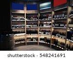 wine bottles on wooden shelves...   Shutterstock . vector #548241691