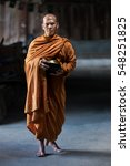 buddhist monks are walking on a ... | Shutterstock . vector #548251825