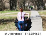 young mother with stroller in... | Shutterstock . vector #548254684